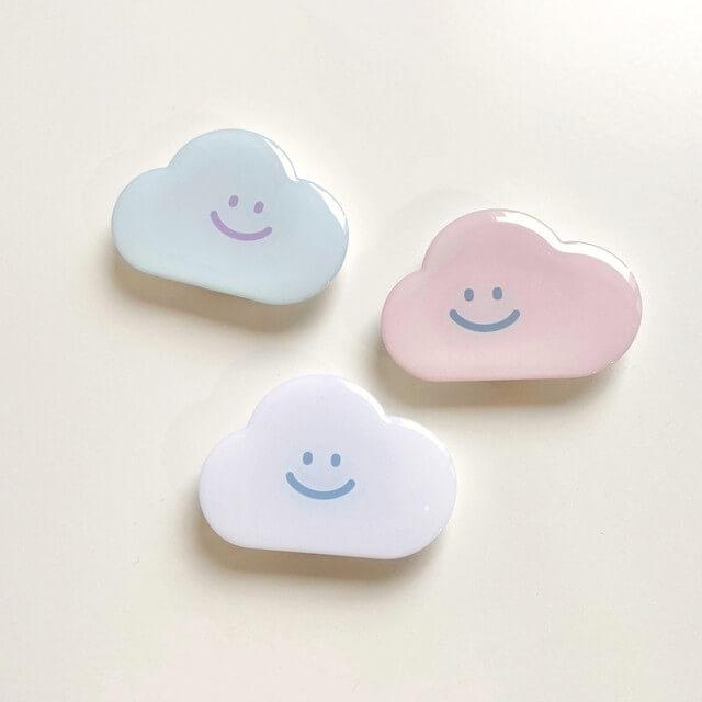 「moim(モイム)」の【skyfolio】くも スマホグリップ ポストカード付き 全3色/¥1,650(税込み)